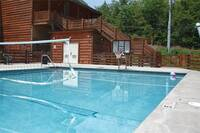 Swimming pool with basket ball and volleyball net