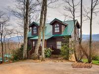 Enjoy mountain views and luxurious amenities at this 3 bedroom cabin just a short drive from downtown Pigeon Forge and Gatlinburg