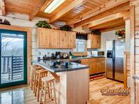 Full kitchen with 4 bar stools and everything you need to cook a meal while on vacation in the Smoky Mountains