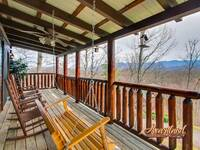 Relax and enjoy a cup of coffee on the porch swing or wooden rocking chairs while taking in the views of the Great Smoky Mountains