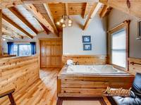 Jacuzzi tub located in the King sez bedroom of this cabin in Gatlinburg