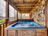 Relax and soak away your stress in the outdoor hot tub at this 3 bedroom cabin in Gatlinburg