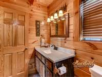 Full bathroom in this Wears Valley log cabin rental