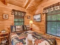 Bedroom of 1 bedroom cabin rental near Gatlinburg