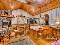 Bedroom with jacuzzi tub and fireplace - 2 Bedroom cabin near Pigeon Forge