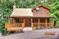 """Beaver Fever"" is a luxury 3 bedroom cabin conveniently located between Pigeon Forge and Gatlinburg in Gnatty Branch Village"