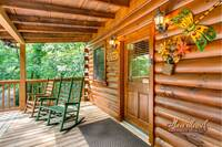 Front porch of this 3 bedroom cabin near Gatlinburg in Gnatty Branch Village