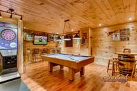 Game room featuring a full-size pool table, and electronic, pub-style dart machine and 50-inch plasma TV