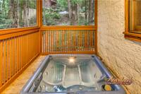 Hot tub on the deck of this luxurious 3 bedroom cabin near Pigeon Forge