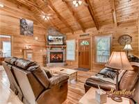 Spacious living room with gas fireplace and flat screen TV
