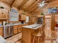 Open kitchen with appliances and seating for 4 people