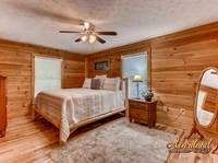 Spacious king bedroom of this 2 bedroom cabin in Pigeon Forge