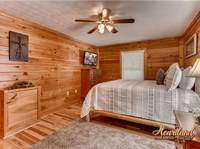 King bedroom of this cabin in Pigeon Forge