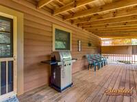 Gas grill on the back deck of this 2 bedroom cabin rental in Pigeon Forge