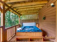 Relaxing hot tub at this 2 bedroom cabin in Pigeon Forge, TN