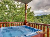 Relax in this luxurious hot tub overlooking the Smoky Mountains