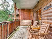 Relax in the rocking chairs and porch swing with checker board