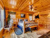 Spacious King bedroom in this 3 bedroom luxury cabin in the Smokies