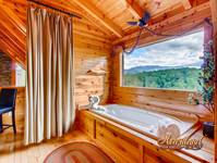 Relaxing jacuzzi tub with views of the Smokey Mountains