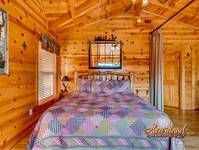 King size bedroom of this 3 bedroom cabin between Pigeon Forge and Gatlinburg