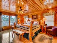 Spacious bedroom of this luxury cabin near Gatlinburg