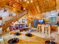 Living room of this 3 bedroom luxury cabin with free wi-fi