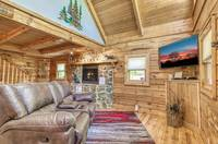 Living room with flat screen tv at Afternoon Delight - 1 bedroom cabin near Pigeon Forge