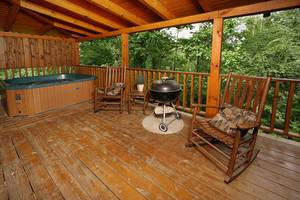 Deck with Rocking Chairs and Charcoal Grill