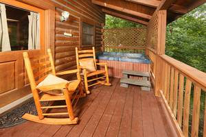 Back Deck with Hot Tub and Rocking Chairs Overlooking Pond