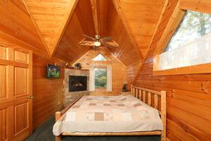 Master Bedroom Upstairs with King Bed, Electric Fireplace, and Large Jacuzzi Tub