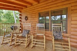 Spacious Deck with Rocking Chairs and Charcoal Grill