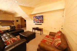 Large Sectional in Downstairs Den with Large TV and Surround Sound
