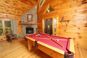 Living Room with Wood Burning Fireplace and Pool Table