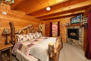 Main Floor Bedroom with King Bed and Gas Fireplace