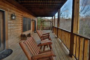 Downstairs Deck with Rocking Chairs and Bench Swing