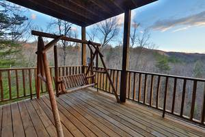 Downstairs Deck with Bench Swing