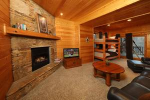 Spacious Den Downstairs with Gas Fireplace and Bunk Beds