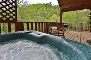 Hot Tub and Rocking Chairs on Private Back Deck