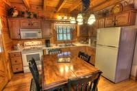 Bears Den Kitchen at Maples Ridge Cabin Rentals In Pigeon Forge Come Enjoy Our Amazing Cabin Just Minutes From Pigeon Forge Sevierville and Gatlinburg. at Bears Den 72 in Gatlinburg TN
