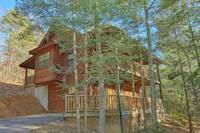 The Outside of the amazing Cedar Falls Resort cabin Hemlock Hideaway. This Cabin is perfect for you and your family to vacation in Pigeon Forge Tennessee at Hemlock Hideaway in Gatlinburg TN