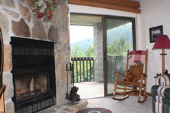 Condo rental in Gatlinburg with a wood burning fireplace.