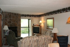 Gatlinburg condo rental with a wood burning fireplace.