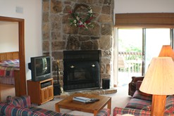 Enjoy the wood burning fireplace at your Gatlinburg condo rental.