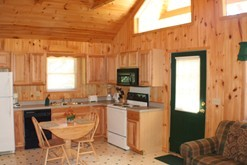 Log cabin rental in Gatlinburg with a fully equipped kitchen.