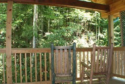 Private Gatlinburg cabins with a covered deck on the creek.