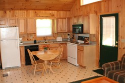 Romantic Gatlinburg log cabin with a fully equipped kitchen.