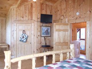 Loft bedroom with tv in View Ober Gatlinburg Cabin