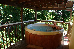 Luxury Chalet Rental in Gatlinburg, TN with private, mountain view hot tub on back deck.