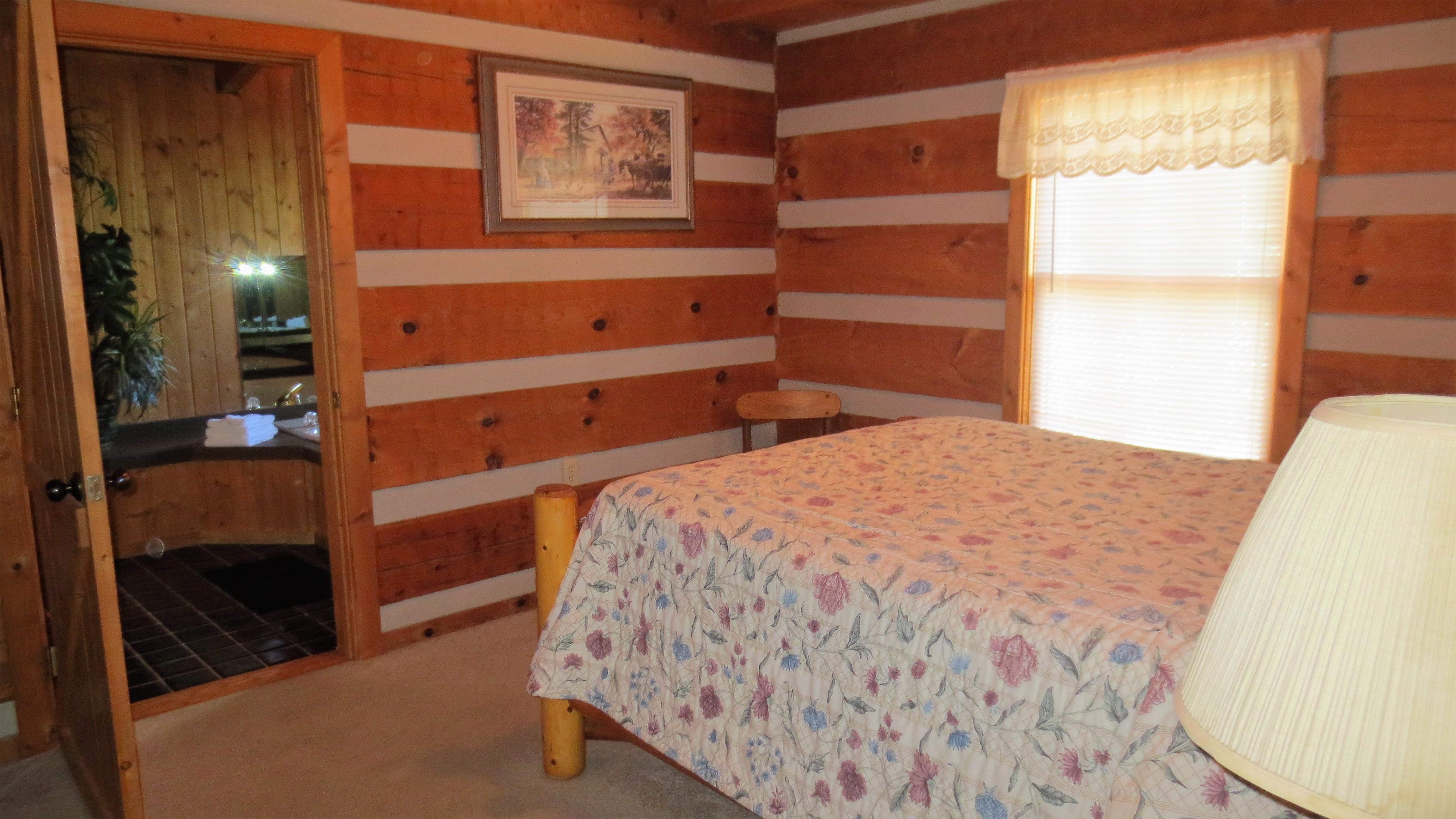 2 gone fishin queen bedroom with adjacent whirlpool room