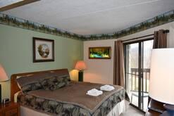 king bed in this 2 bedroom 2 bath condo in galtinburg